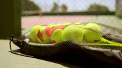 Number of tennis balls on a racket for training Stock Footage