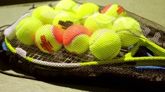 Net bag of tennis balls for training on a racket Stock Footage
