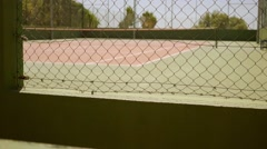 Empty outdoor all weather tennis court Stock Footage