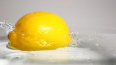 Lemon swirling in water Stock Footage