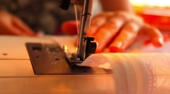 The woman begins to sew on the sewing machine Stock Footage