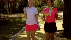 Two young woman friends at the tennis club Stock Footage