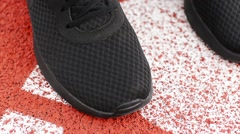 Man Tying Sports Shoe Before Morning Exercise on the Stadium. Close up View Stock Footage