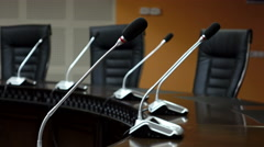 Dolly shot of microphones in modern conference room. Shallow DOF Stock Footage