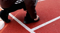 Sport Man Tying Black Sports Shoe Before Morning Exercise on the Stadium Stock Footage