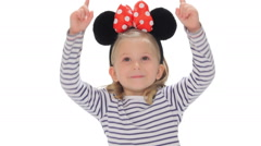 Little girl points in the air Stock Footage