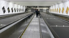 STOCKHOLM: POV point of view of going down an escalator in a metro station - stock footage