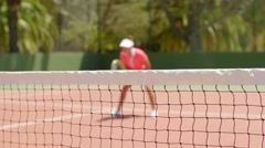 Athletic shapely woman playing a game of tennis Stock Footage