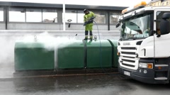 Street cleaner use high pressure water clean waste separation garbage container Stock Footage