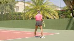 Female tennis player preparing to serve Stock Footage