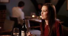 4K Cute couple on date in restaurant enjoying their meal & chatting Stock Footage