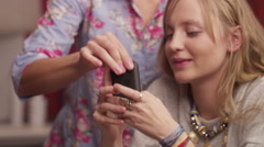 Mother needs attention and she takes away a cell phone from her daughter Stock Footage