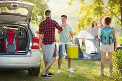 Camping trip, Young happy people say hello arrived friends Stock Photos