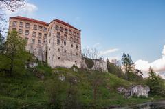Renaissance castle in Pieskowa Skala on a cloudy day - stock photo