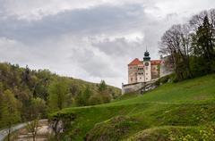 Renaissance castle in Pieskowa Skala on a cloudy day Stock Photos