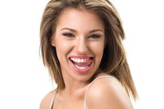 Attractive young woman with toothy smile - stock photo