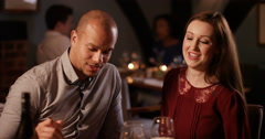 4K Affectionate couple eating out, man feeds his partner a taster of his meal Stock Footage