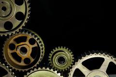 Interlocking industrial  cogwheels top view on black background - stock photo