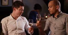 4k, two friends in a restaurant toasting wine glasses. - stock footage
