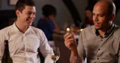 4K 2 Men laughing & enjoying a meal out, man offers friend a taste of his meal Stock Footage