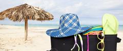 Suitcase with bikini and sunglasses. Stock Photos