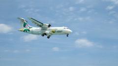 Air Antilles ATR 42-500 plane landing at St Maarten airport. - stock footage