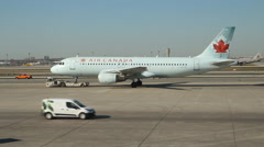 Air Canada Airbus 320 plane being towed on the tarmac in Toronto. Stock Footage