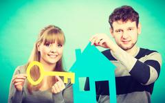 Couple project their first house. - stock photo