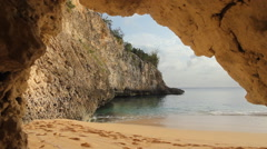 Cave view of cove at Baie Longue in St Martin, Caribbean. Stock Footage