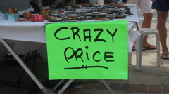 Crazy price sign at market stall. Marigot, St Martin, Caribbean. Stock Footage