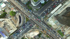 aerial top view of traffic and vehicle car on crossroad or junction in bangkok - stock footage