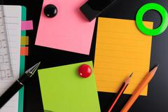 Office objects over blackboard background. - stock photo