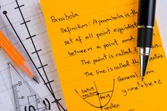 Lecture Notes in Mathematics. Parabolas and quadratic theory. - stock photo