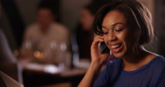 4K Confident female bar owner working at night, makes phone call to an associate Stock Footage
