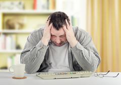 Portrait of bipolar disorder man sitting at the desk - stock photo