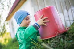 Portrait of a little boy dumping a grass Stock Photos