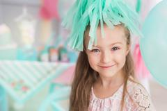 Portrait of a beautiful little girl in a colorful room Stock Photos