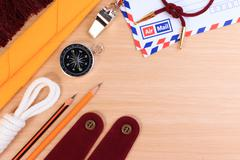 Orderliness white scout rope, scarf, whistle, pencil, compass, envelope and b - stock photo