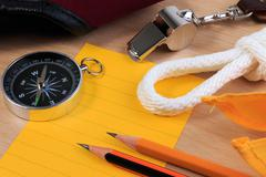Orderliness white scout rope, scarf, whistle, compass, pencil and paper note Stock Photos