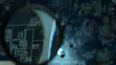 Mainboard Through a Magnifying Glass Stock Footage