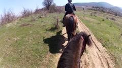 Riding Horse tour on narrow mountain path Stock Footage