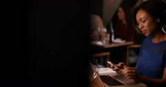 4K Professional woman with laptop in restaurant, makes phone call to a colleague Stock Footage