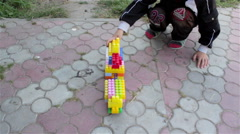 Play with toys in the yard Stock Footage
