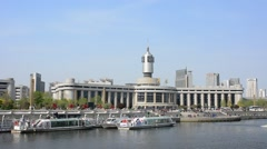 Tianjin railway station with tourist boat is crossing the   river. Stock Footage