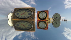 Many various clocks on mirror beneath cloudy sky, time lapse 4K - stock footage