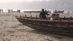 Varanasi, India, December 2012  - men working on big boat by river Ganges Stock Footage