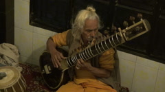 Varanasi, India, December 2012 - old man playing Indian sitar Stock Footage