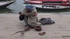 Varanasi, India, December 2012 - cobra charmer with walkers by Stock Footage