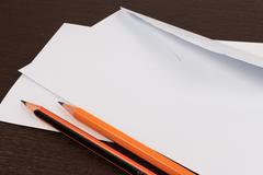 White envelopes with pencil on wooden table. Stock Photos