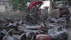Jaipur, Rajasthan, India, December 2012 - metal scrap yard full of vehicles Stock Footage